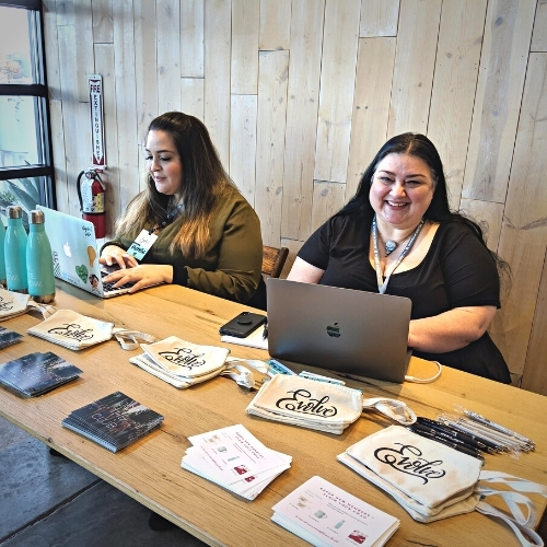 Deb de Freitas checks people in at a Austin Together Digital event