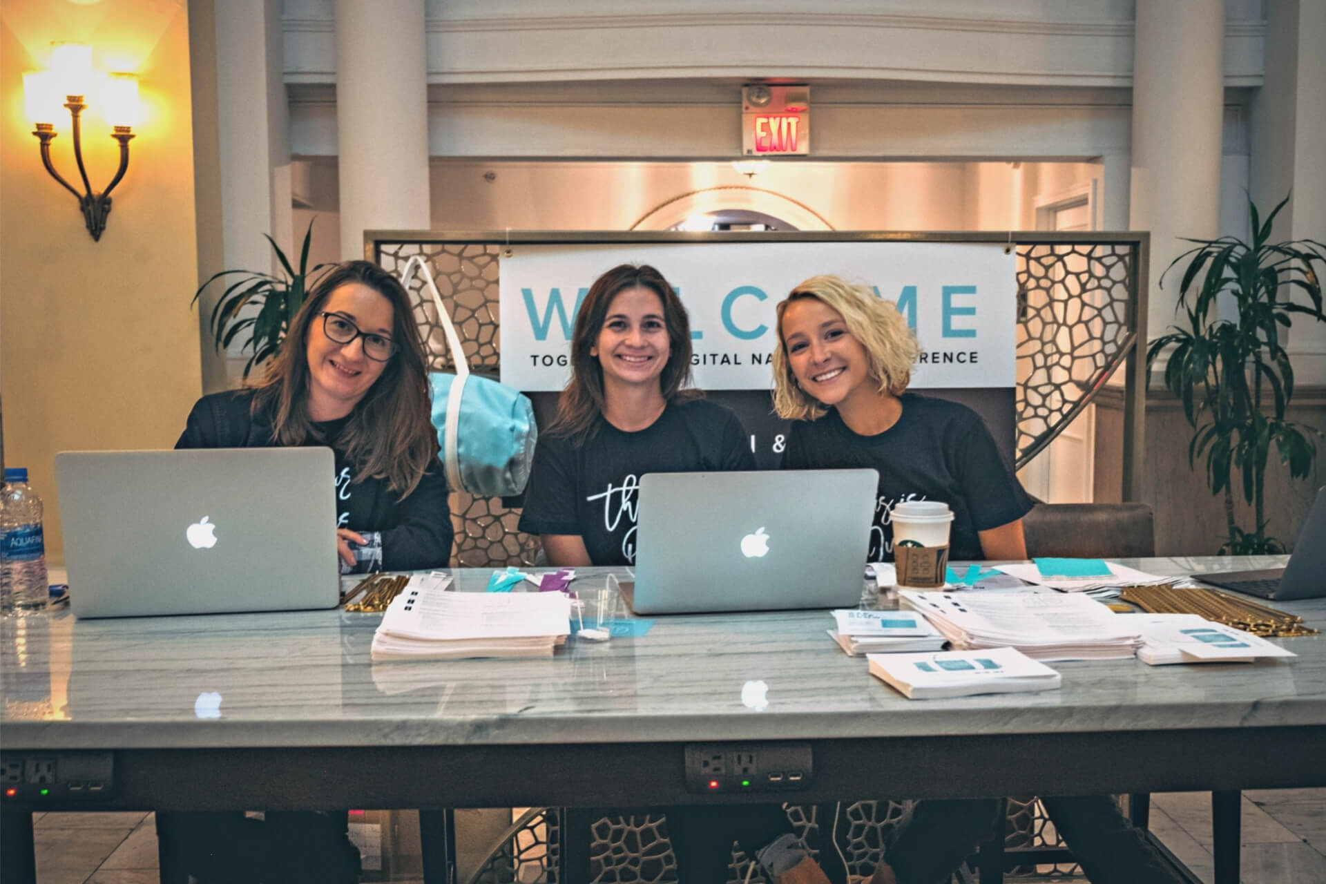 3 Women check people in at the 2019 National Conference